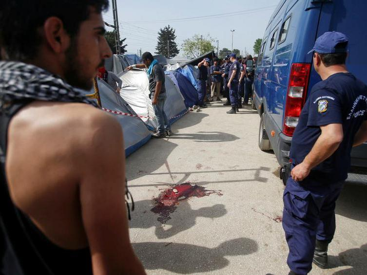 Blood is seen on the ground after clashes between migrants and police at a makeshift camp for migrants and refugees at the Greek-Macedonian border near the village of Idomeni, Greece, April 18, 2016. REUTERS/Stoyan Nenov