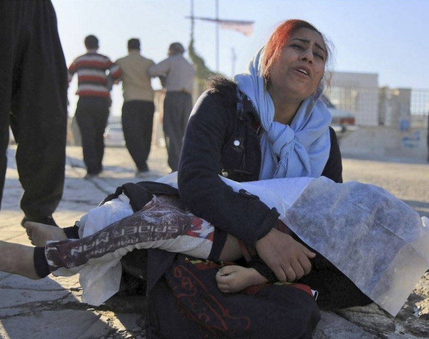 In this photo provided by Islamic Republic News Agency, IRNA, a woman moans as she holds the body of her daughter, who was killed in an earthquake, in Sarpol-e-Zahab, in western Iran, Monday, Nov. 13, 2017. A powerful 7.3 magnitude earthquake that struck the Iraq-Iran border region killed more than three hundred people in both countries, sent people fleeing their homes into the night and was felt as far west as the Mediterranean coast, authorities reported on Monday. (Mosleh Pirkhezranian/Islamic Republic News Agency,IRNA, via AP)