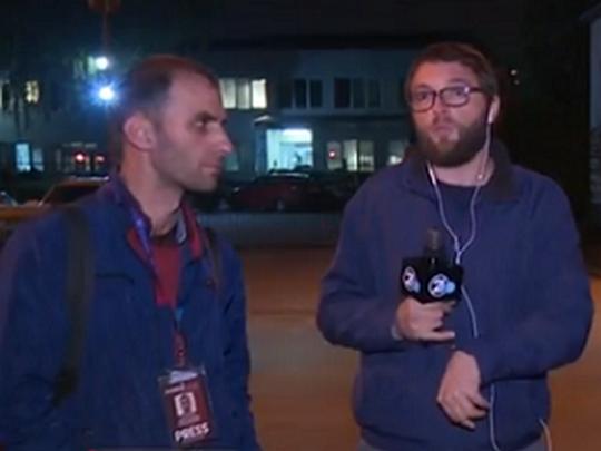 novinari privedeni