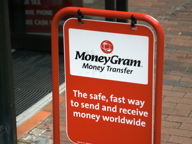 MoneyGram money transfer street advert outside shop (Photo by: Geography Photos/Universal Images Group via Getty Images)